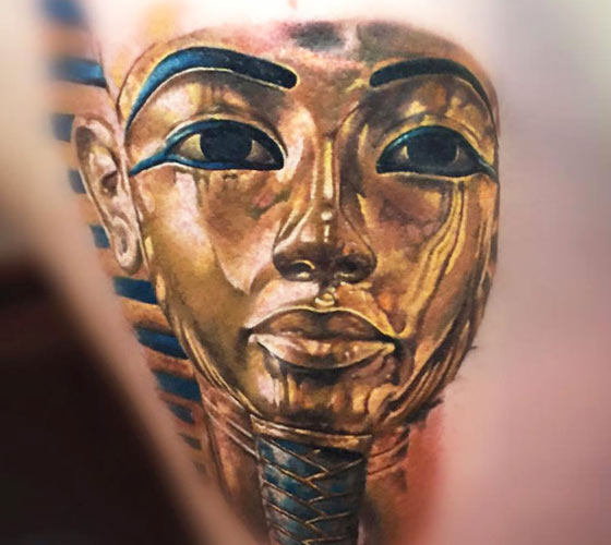 Tutankhamun gold Mask tattoo by Zsofia Belteczky